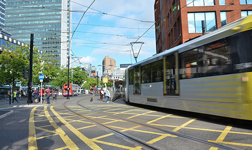 A tram leaving Piccadilly gardens in Manchester city centre